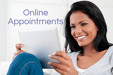 Woman looking at her ipad having an online cfertility consultation